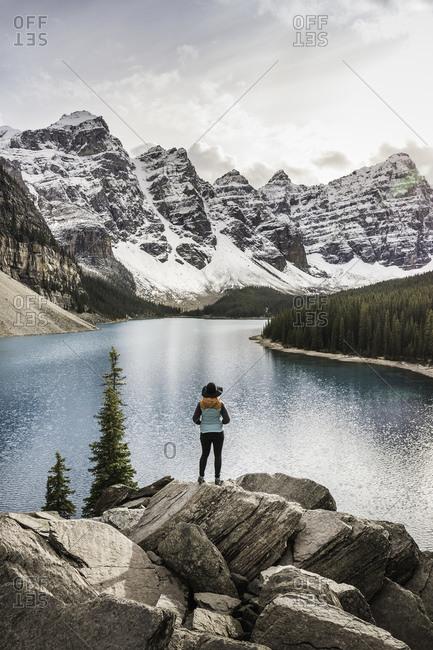 Woman standing, looking at view, Moraine Lake, Lake Louise, Alberta, Canada