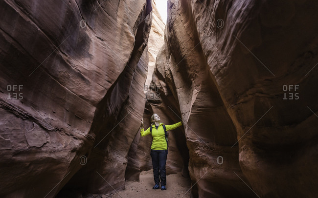 Woman exploring slot canyon Grand Staircase-Escalante National Monument, Utah, USA