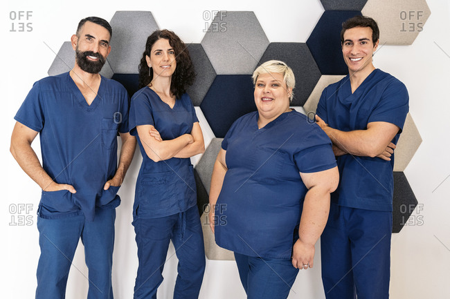 Group of dental professionals dressed in blue scrubs