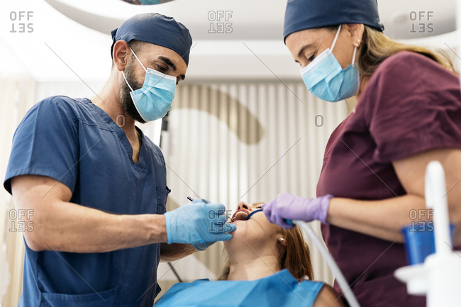 Woman having a dental exam on a woman in a clinic