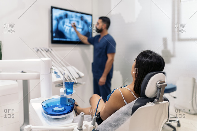 Dentist reviewing patient x-rays in a dental clinic