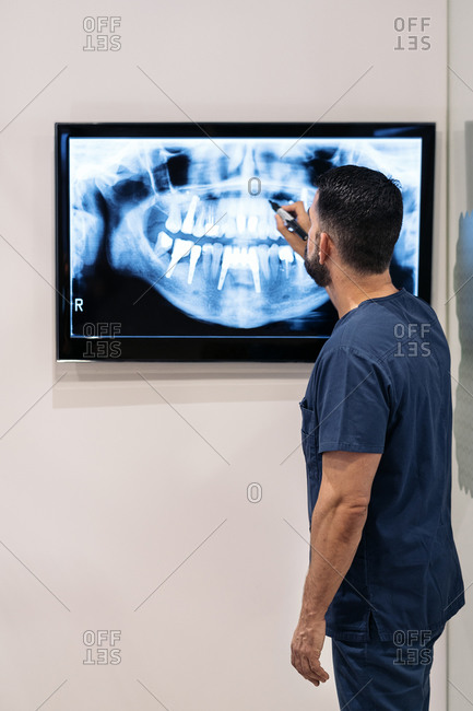 Dentist reviewing x-rays in a dental clinic