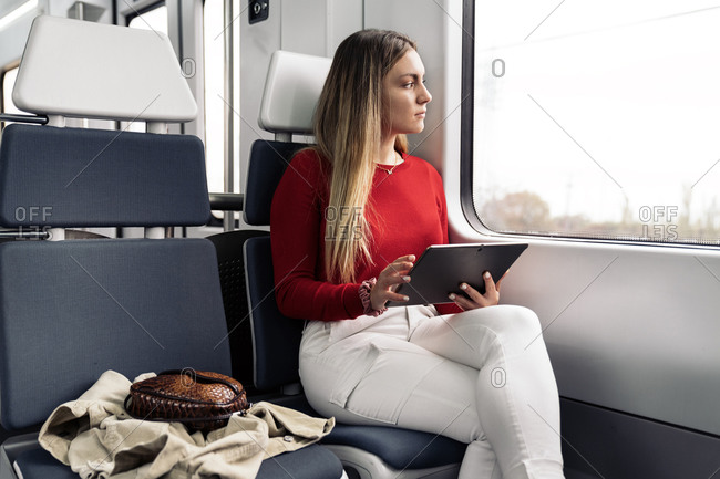 Young attractive woman using a tablet during her journey