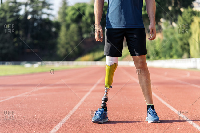 Close up disabled male athlete with leg prosthesis