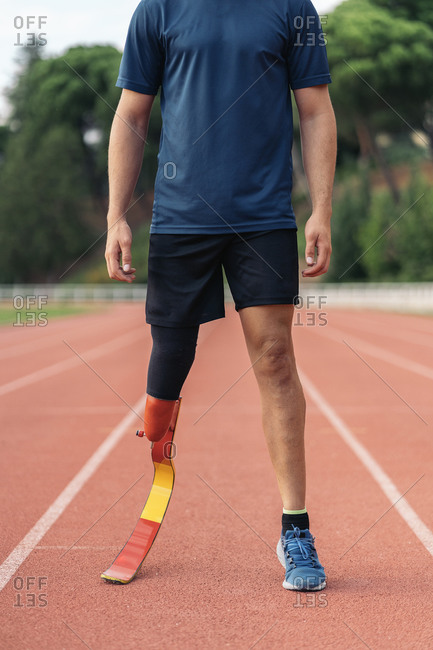 Close up disabled male athlete with a running leg prosthesis