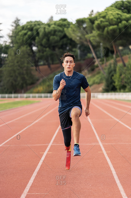 Disabled athlete training with leg prosthesis on a running track