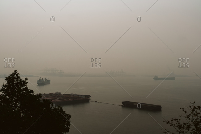 Hazy sky over ships in the harbor in Seattle, Washington