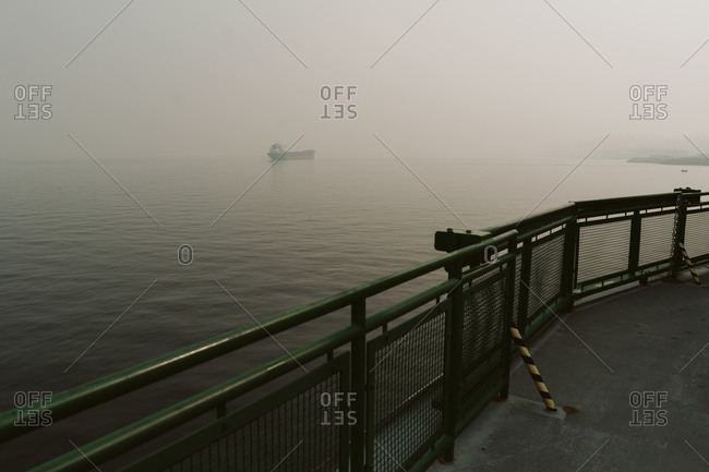 Looking out from a ferry boat over hazy wildfire smoke over the Pacific Ocean