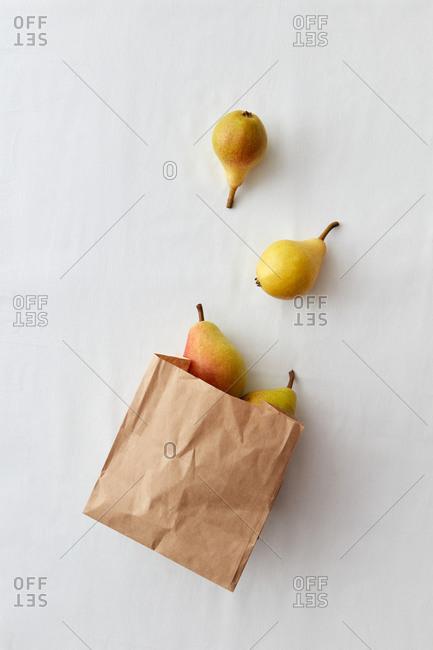Ripe fresh sweet pears fruits in a paper bag.
