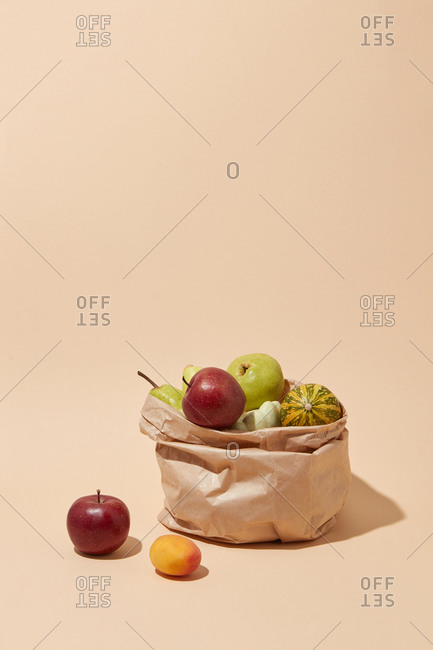 Paper eco bag with natural organic apples and fruits.
