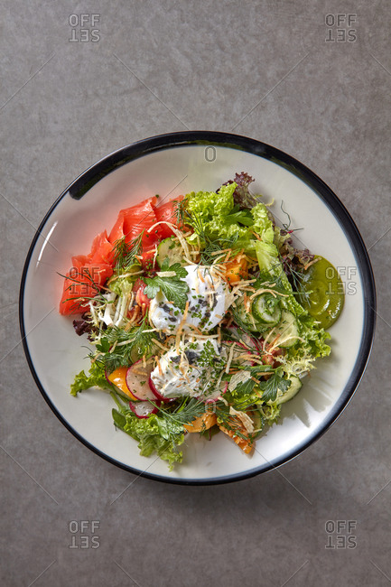 Fresh natural green leaves salad with salted salmon.