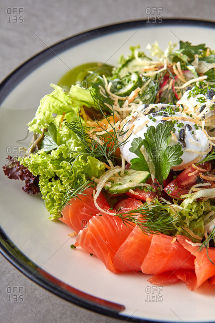 Close-up fresh natural salad with salted salmon.