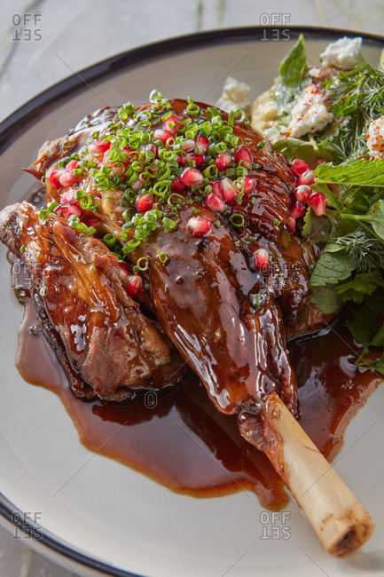 Stewed lamb shank with herbs and vegetables.