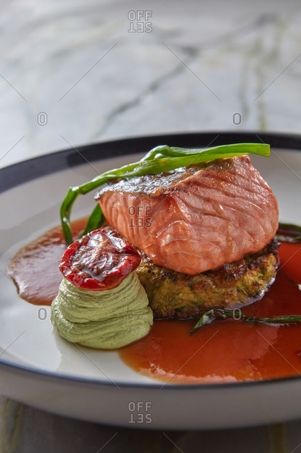 Grilled salmon with zucchini pancake and bonito sauce.