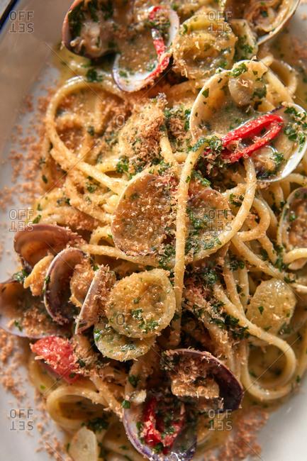 Close up view spaghetti, vongole mollusc and botarga.