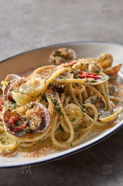 Cooked spaghetti with vongole mollusc and botarga.