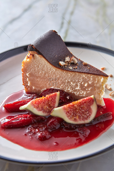 Sweet tasty basque cheesecake with plums sauce.