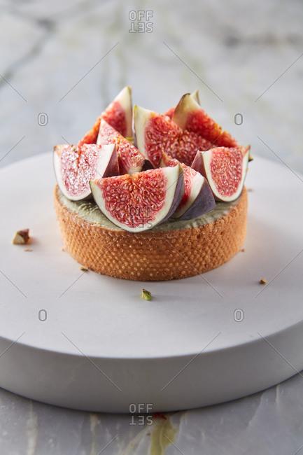Sweet tasty pistachio tart with fresh figs.