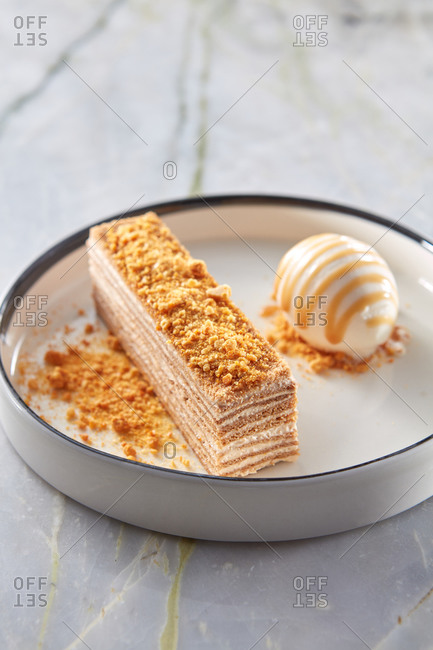 Honey cake with melted sour cream and sweet ice cream.
