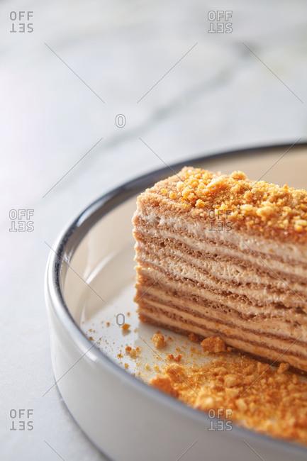 Close up of honey cake with sour cream and ice cream.