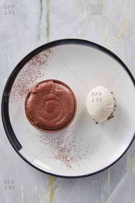 Top view chocolate souffle tart with cardamon ice cream.