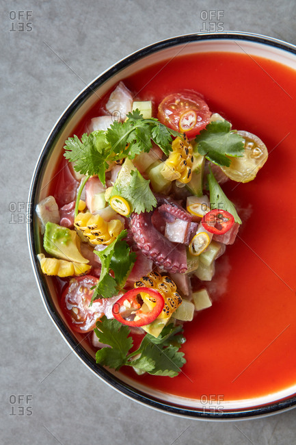 Fresh salad from fresh corn, tomatoes and octopus.