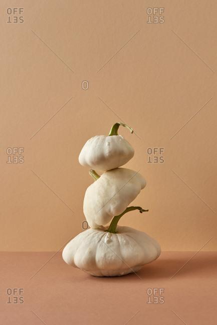 Balancing pyramid from white natural organic squashes.
