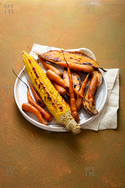 Roasted vegetables on white plate