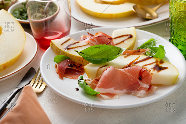 Close up of melon and ham on a plate
