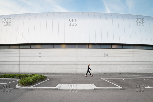 Lund, Sweden - June 13, 2020: Woman walking outside in front of the Max IV Laboratory