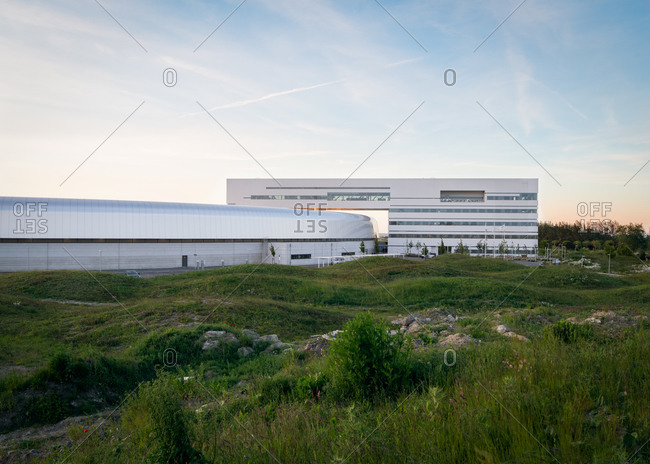Lund, Sweden - June 13, 2020: Exterior of the Max IV Laboratory surrounded by rolling hills