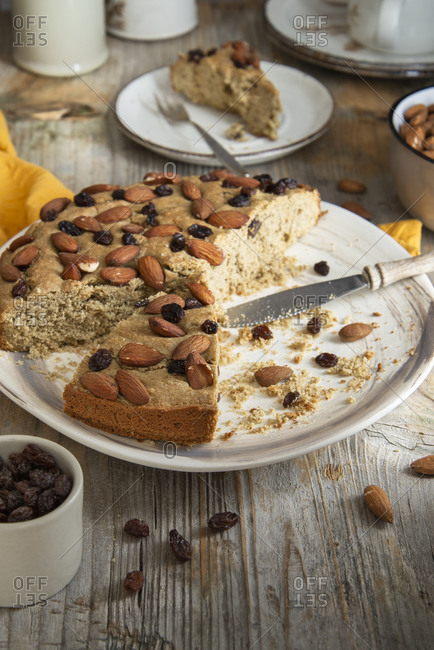 Baked sorghum cake with almond and raisin being served