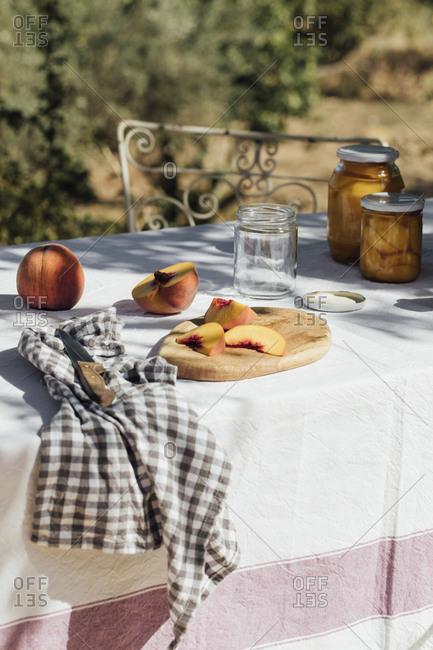 Peaches and jars on a quaint garden table