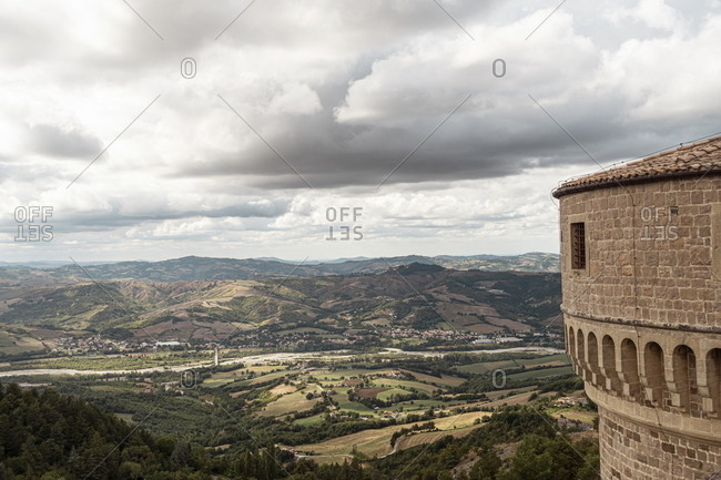 View of countryside and tower of the Fortress of San Leo, Marche, Italy