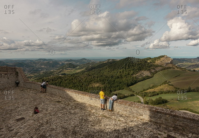 Marche, Italy - August 5, 2020: Tourists overlooking the countryside from atop of the Fortress of San Leo