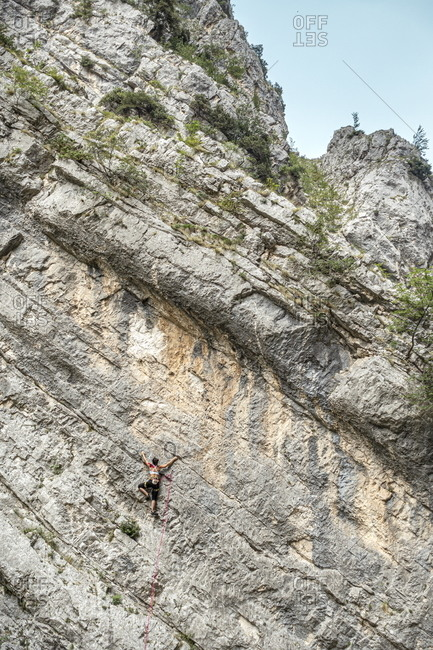 Rock climber hanging from side of mountain, Fara San Martino, Abruzzo, Italy