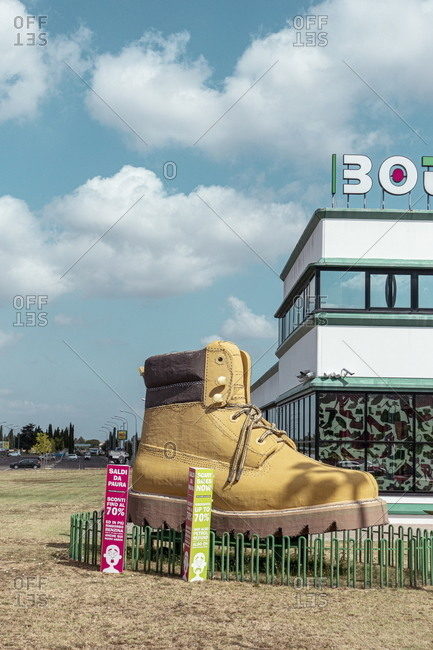 Lajatico, Italy - August 15, 2020: Large boot on display at a shopping mall