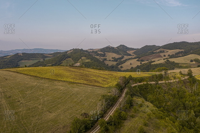 Bird's eye view over rolling hills in rural Piandimeleto, Marche, Italy