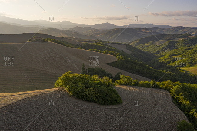 Sunset over rolling hills and farmland in rural Marche, Italy