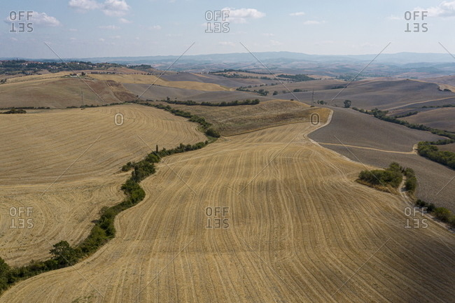 Aerial view over vast farmland in rural Lajatico, Italy