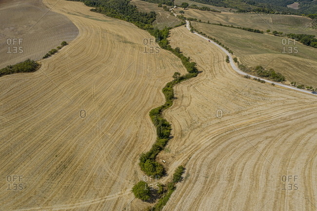 Aerial view over agricultural fields in rural Lajatico, Italy