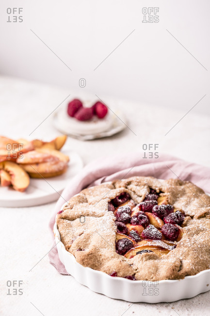 Peach and raspberry galette made with fresh yellow peaches and brown sugar