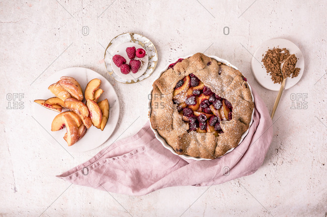 Delicious peach galette made with fresh yellow peaches, brown sugar and raspberries