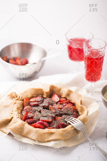 Preparing a strawberry galette with vanilla bean and chia seeds