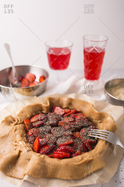 Close up of strawberry galette with vanilla bean and chia seeds being prepared