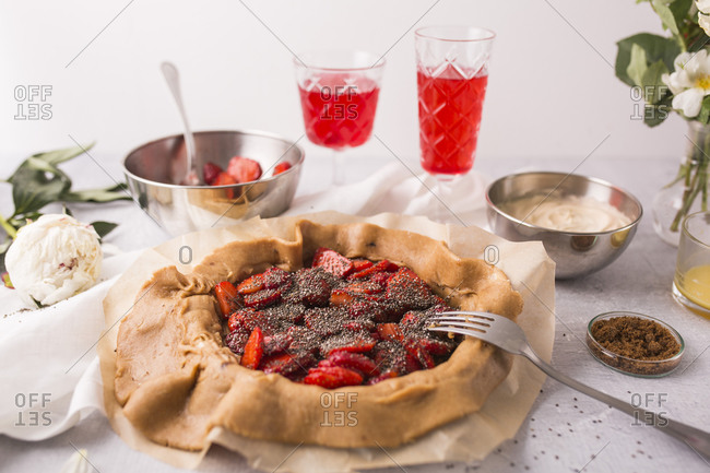 A strawberry galette with vanilla bean and chia seeds in progress