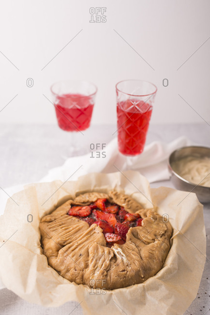 Strawberry galette with vanilla bean and chia seeds ready to be baked