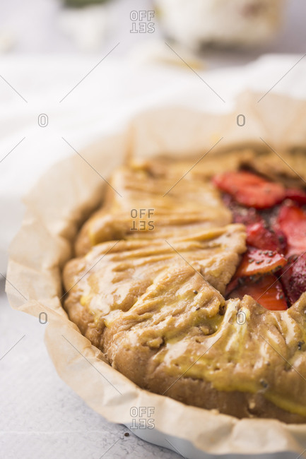 Close up of a strawberry galette with vanilla bean and chia seeds ready to be baked