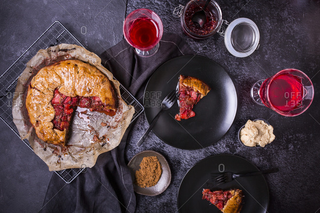 Strawberry galette with vanilla bean and chia seeds being served on dark background