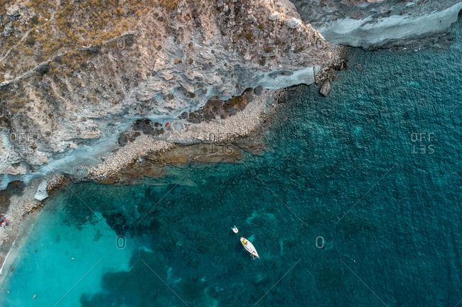 Spectacular aerial view of calm sea with clear turquoise water and rocky coastline